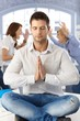 Businessman meditating at office