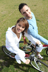 Couple relaxing on a bicycle