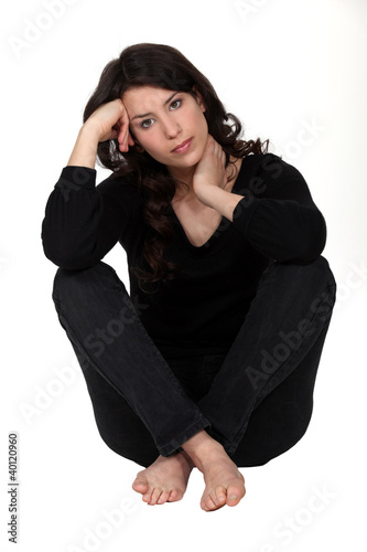 Thoughtful woman wearing black casual clothes