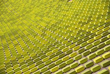 pattern of green seats in a sport stadium