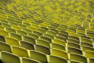 A pattern of green seats in a sport stadium