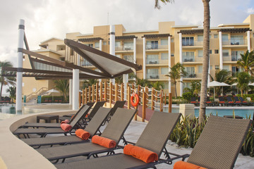 Brown Rattan Chaise Lounges with Orange Towels