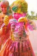 Holi celebrations in India. Two Indian kids playing Holi