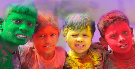 Holi celebrations in India. Group of kids playing Holi.