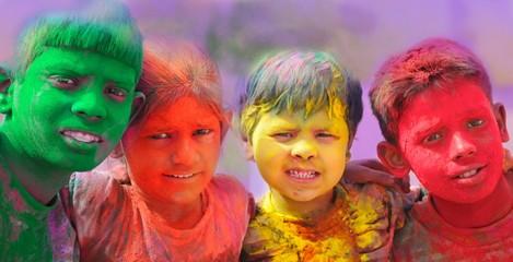 Holi celebrations in India. Group of kids playing Holi.