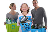 Girl and parents recycling