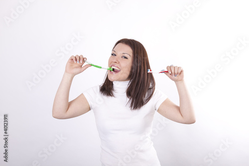 Young beautiful woman with two toothbrushes