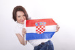 Young woman holding a flag of Croatia and smiling