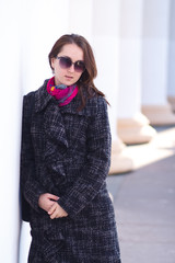 Smiling woman wearing coat outdoor. Early Spring
