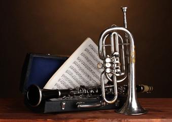 antique trumpet and clarinet in case