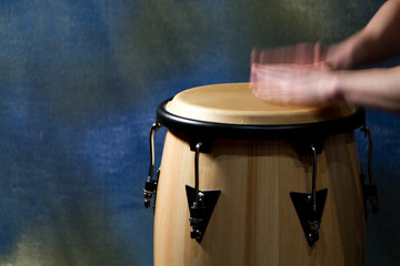 Musician playing conga, blurred hands