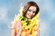 easter picture of young woman with yellow feathers