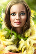 easter picture of young woman with feathers green background