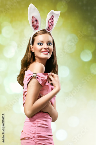 easter picture of young woman wearing pink easter bunny costume