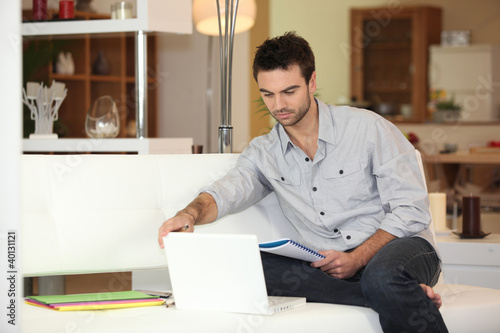 man sitting on the couch with a computer