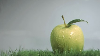 Raindrops in super slow motion falling on an apple