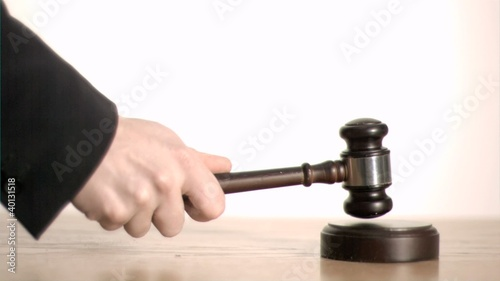 Judge in super slow motion holding a gavel