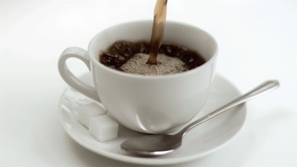 Americano coffee in  super slow motion filling a cup