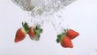 Delicious strawberries in super slow motion falling