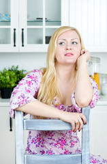 Blond woman sitting on the chair
