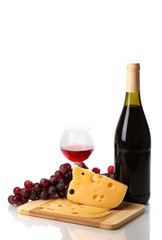 Bottle of great wine with wineglass and cheese isolated on white