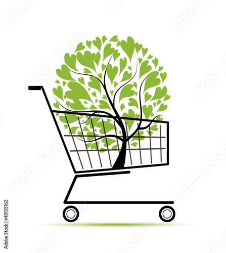 Green tree in shopping cart for your design
