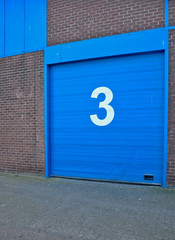 Blue painted garage door in an old building