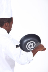 black chef with frying pan