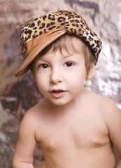 little cute boy in cap
