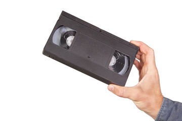 Videotape, videocassette in hand. On a white background.