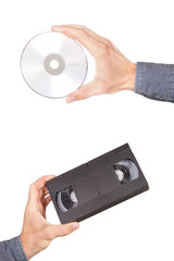 Videotape and cd drive in your hand. On a white background.