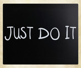 """Just Do It"" handwritten with white chalk on a blackboard"