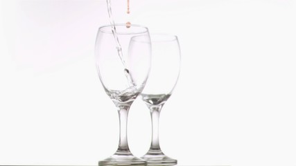 Water and wine poured in super slow motion
