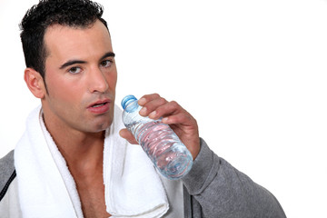 Athlete drinking water after physical effort