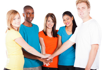 group of young multicultural people hands together