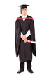 young male graduate in cap and gown full length