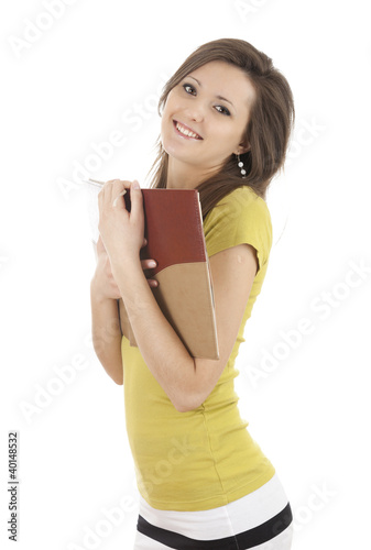 smiling student girl with books looking at the camera