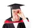 funny male graduate looking through certificate