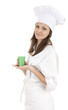 young chef woman in white workwear with green cup