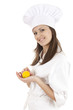 young chef woman in white uniform and hat with lemon