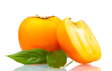 One and half appetizing persimmon with green leaves isolated