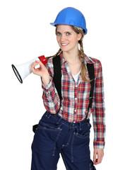 Tradeswoman holding a megaphone