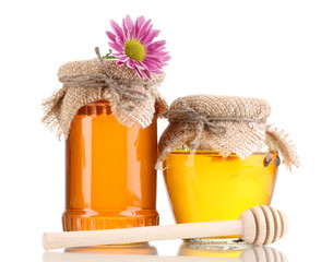 Sweet honey in jars with drizzler isolated on white