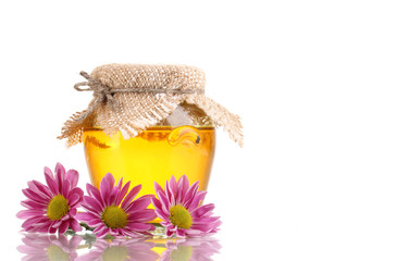Sweet honey in jar isolated on white