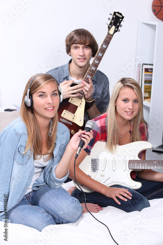 Teenagers making music in a bedroom