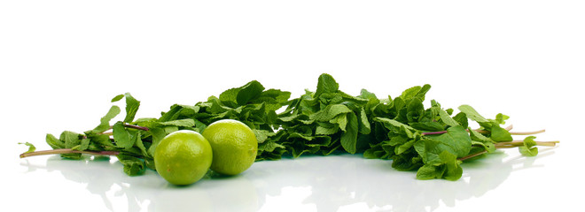 Fresh mint and limes isolated on white