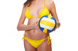 Woman in yellow swimsuit holds a ball