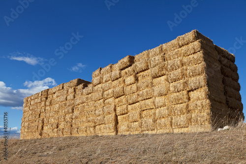 Large pile of hay bales