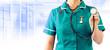 staff nurse holding stethoscope