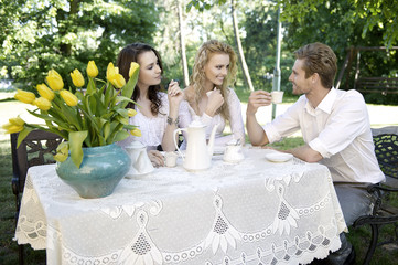 Friends having good time in summer garden